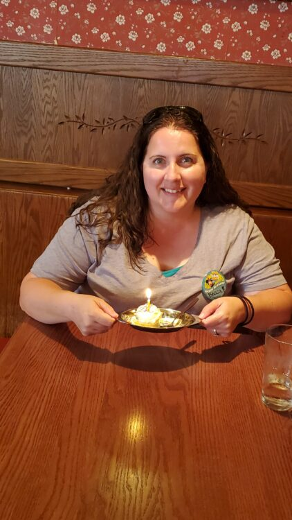Birthday ice cream at carnation cafe, woman smiling with ice cream.