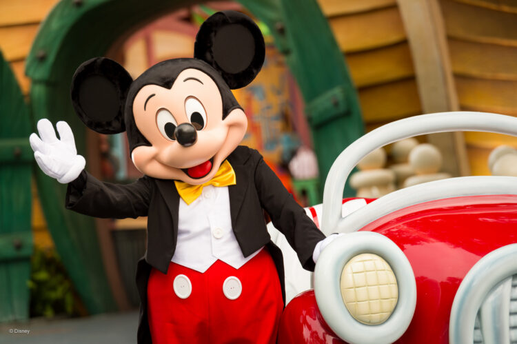 Mickey, standing by his car in front of his garage/house at Disneyland in Mickey's Toontown.