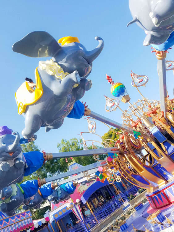 Dumbo the Flying Elephant Ride in the air at Disneyland resort. Sunny day